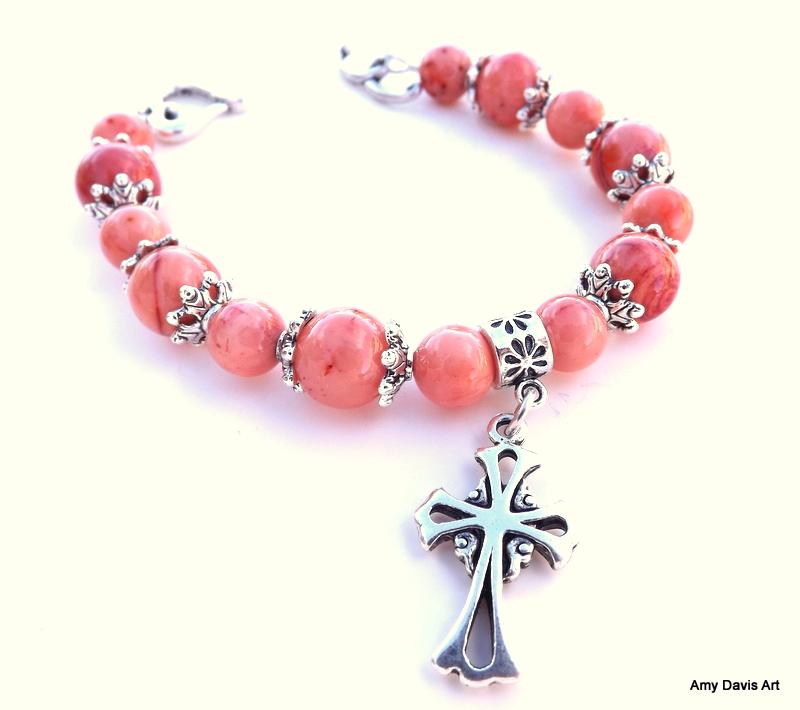 Christian cross bracelet with light orange beads