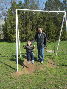 He loved to be pushed on the swings!