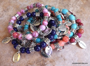 A stack of Fruit of the Spirit Charm bracelets