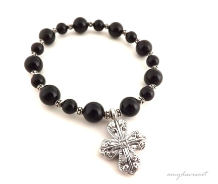 Women's bracelet with black onyx beads and silver pewter cross
